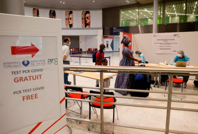 passengers line up for free covid tests at Paris Charles de Gaulle airport
