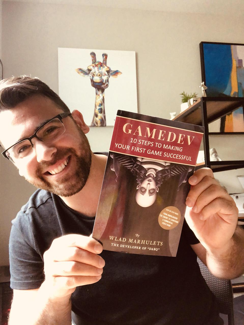 Zane Pickett holding GAMEDEV: 10 Steps to Making Your First Game Successful