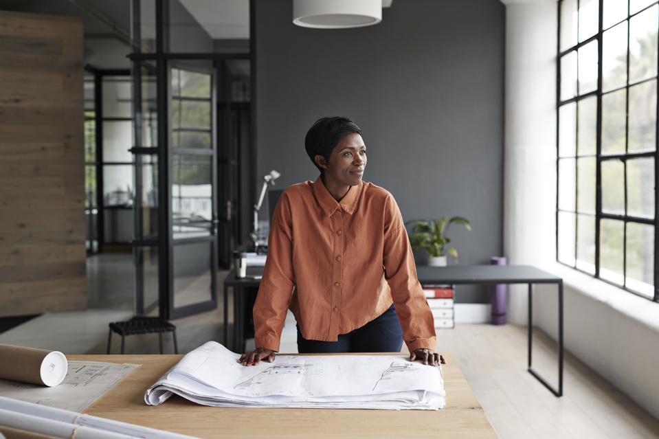 Entrepreneur looking away at workplace