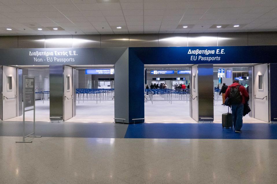 EU and Non EU Passport Control At Athens Airport Greece with travel bans empty