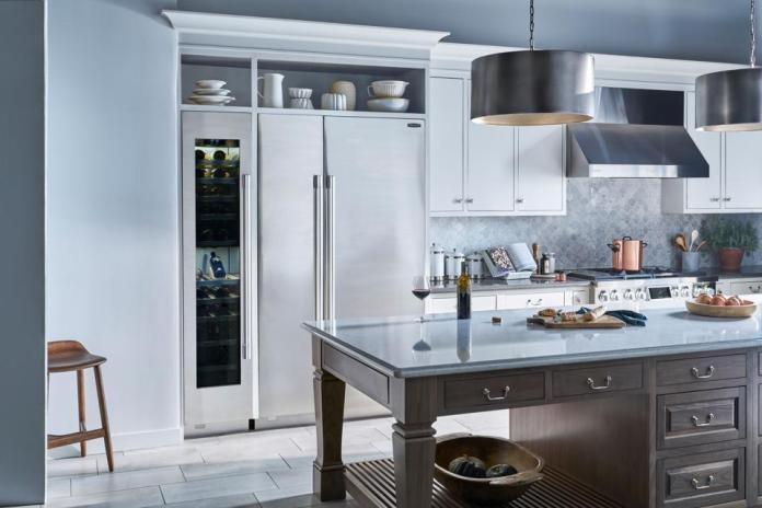 Kitchen with vent hood.