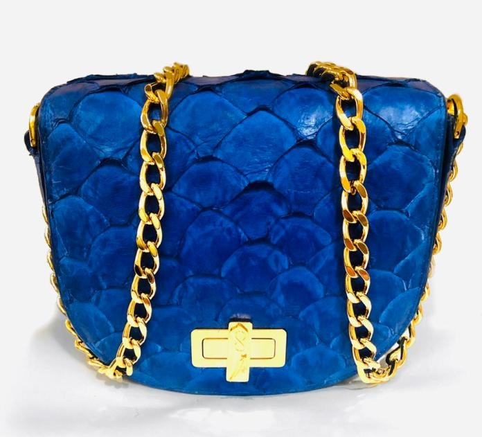Indigo, fish skin clutch bag, sustainably sourced with gold accents and chain.