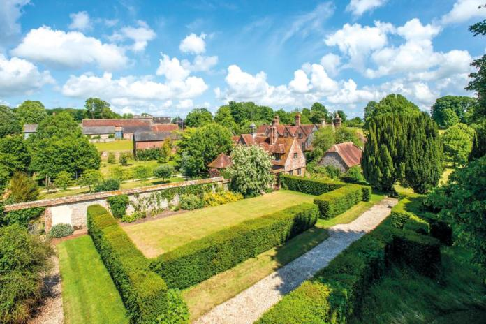 The gardens, outbuildings, and cottages