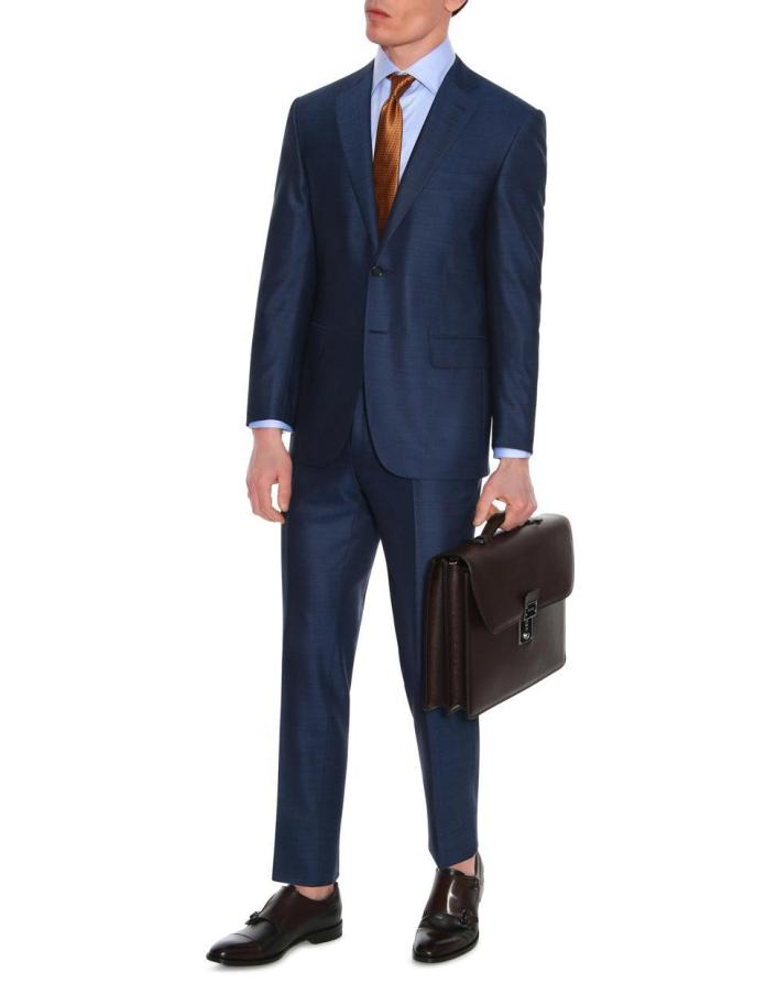 Canali: Made in Italy of 100% wool, this suit speaks to both classic tailoring and a heritage of suit making, with a contemporary silhouette and impeccable construction that will last a lifetime.