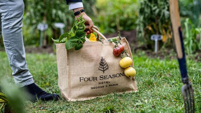 Burlap farmer's market bag with produce.