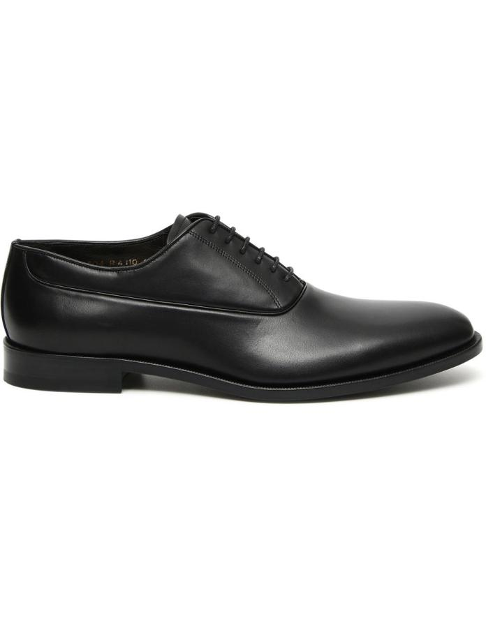 The shoe's soft silhouette and leather sole ensure a comfortable fit while the hand-buffed finish offers a truly distinctive aesthetic.