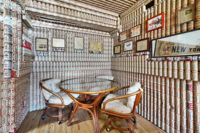 Budweiser cans line the walls of a living room in Florida.