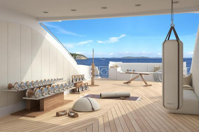 A gym on board a yacht overlooking the ocean.