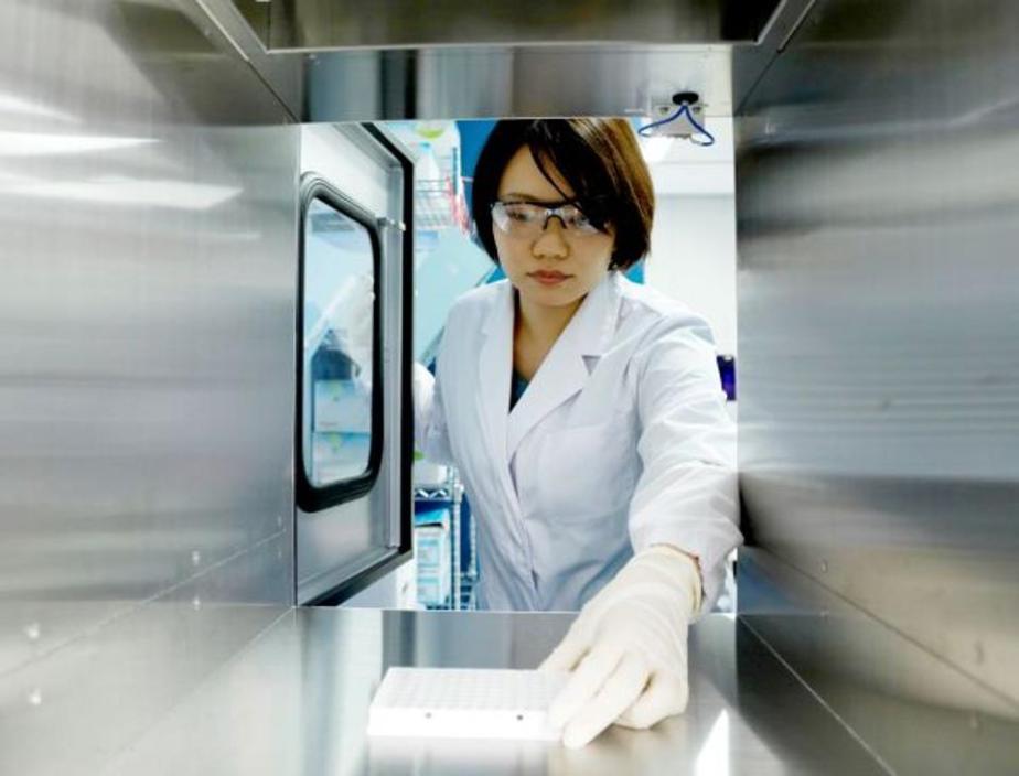 A technician prepares samples at PFDeNA's lab in Tokyo