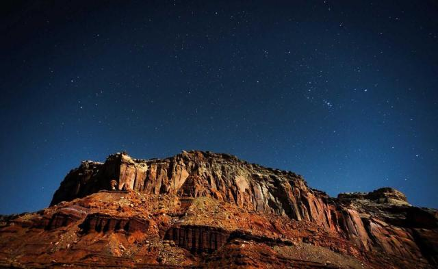 Orion and the stars above a formation in Canyonlands