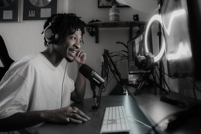 Man chatting on a web meeting using the Shure SM7V microphone