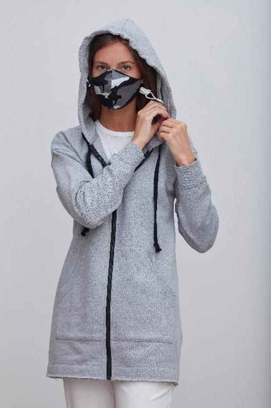 woman in mask and hoodie,