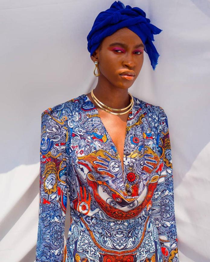 Cowl neck mermaid gown made from reclaimed fabric from @patrickayanski  @chinemerem._ as a shot by @asamaiige styled by @ikechukwuurum of @theqraftcompany assisted by @isaintlu.co beauty by @facesbymaraan