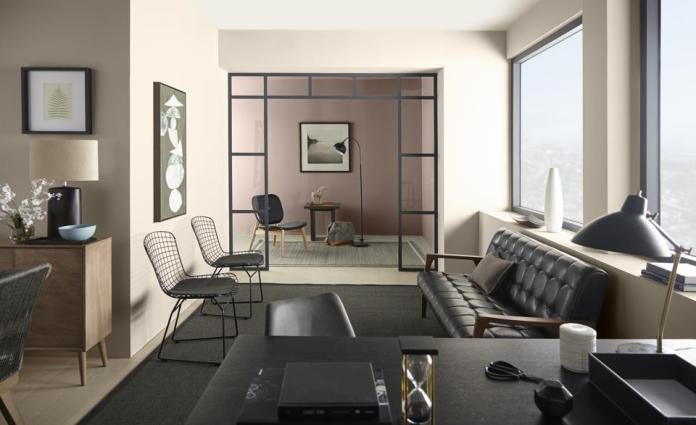 A neutral office space with mid-century furnishings and Behr's Almond Wisp paint