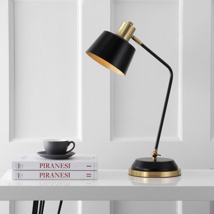 An Eyeley task lamp brightens an all-white workspace.