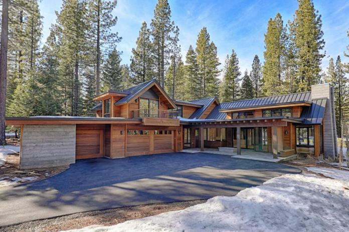 Tall evergreen trees sit in the backdrop of a contemporary-style chalet home in Truckee, Calif., resort community.