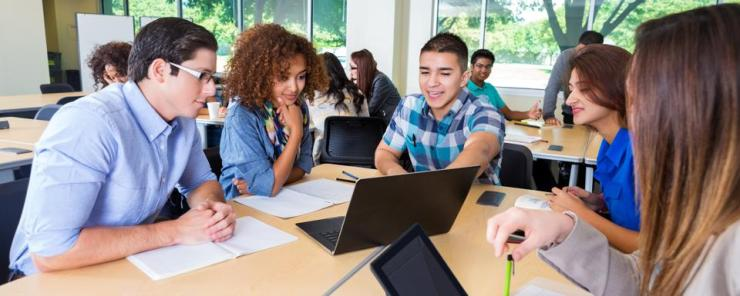 College study group brainstorming together in classroom or library