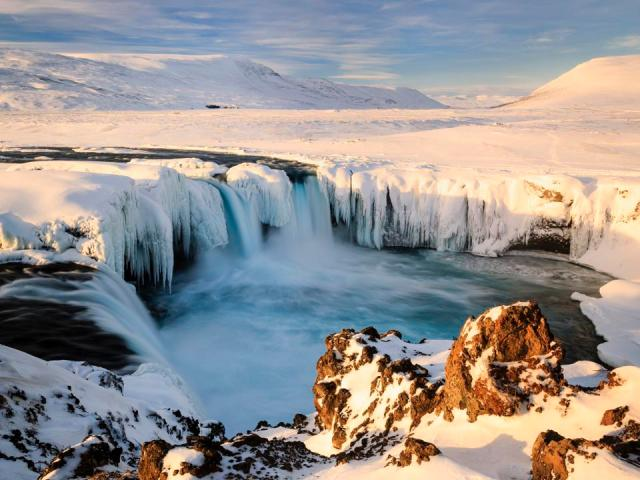 Morning sunshine at Godafoss Waterfall in Iceland.
