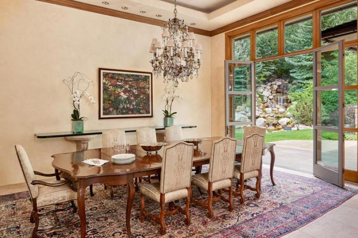 The home's formal dining room overlooking a backyard waterwall.