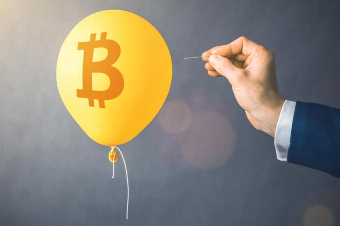Bitcoin cryptocurrency symbol on yellow balloon. Man hold needle directed to air balloon. Concept of finance risk