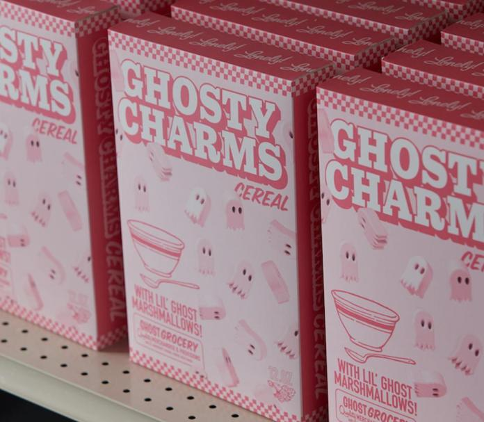 Pink cereal boxes on a grocery store shelf.