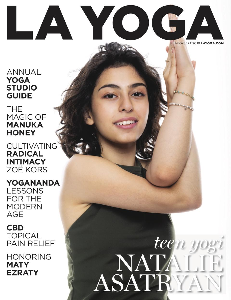 a young girl in a yoga pose on the cover of LA Yoga magazine