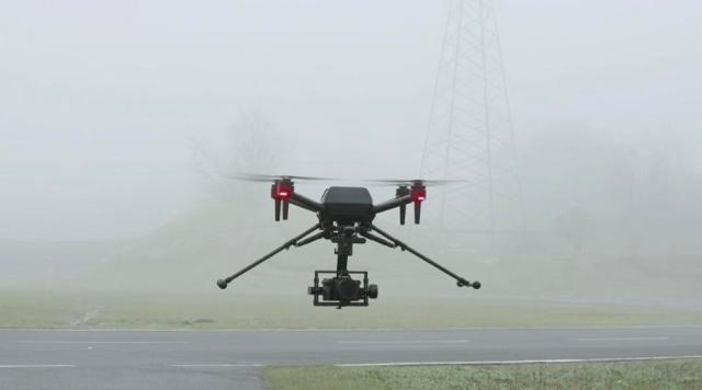 Drone filming foggy field