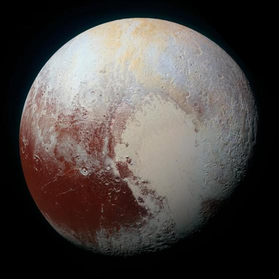 An enhanced global view of color Pluto, taken when NASA's New Horizons spacecraft was 450,000 kilometers away.