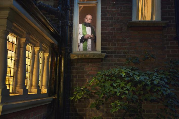 Sony World Photography Awards: a priest looking out from church window