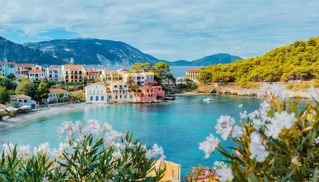 Scenic View Of Sea And Buildings Against Cloudy Sky in Kefalonia, Greece