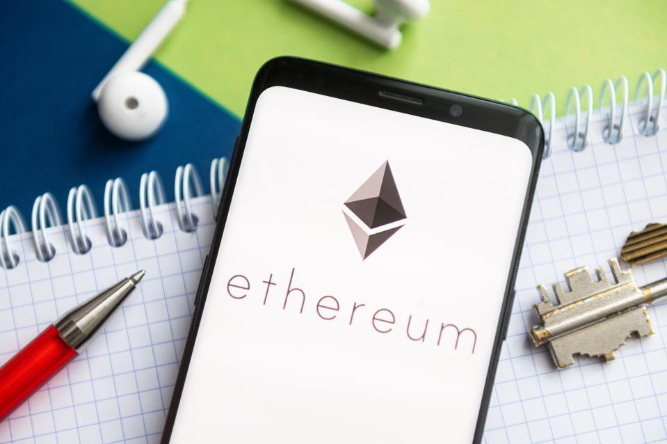 In this photo illustration, a Ethereum logo seen displayed...