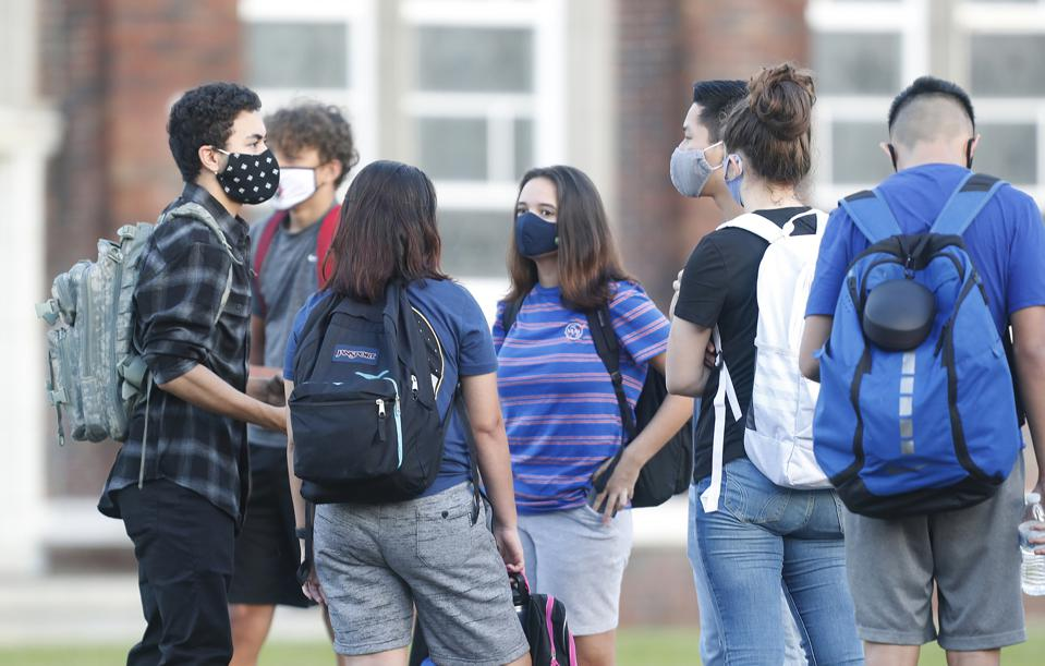 Tampa-Area Chidren wearing masks as they Return To Classrooms On First Day Of School