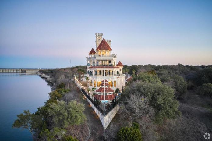 The lakeside home looks like a castle on a point