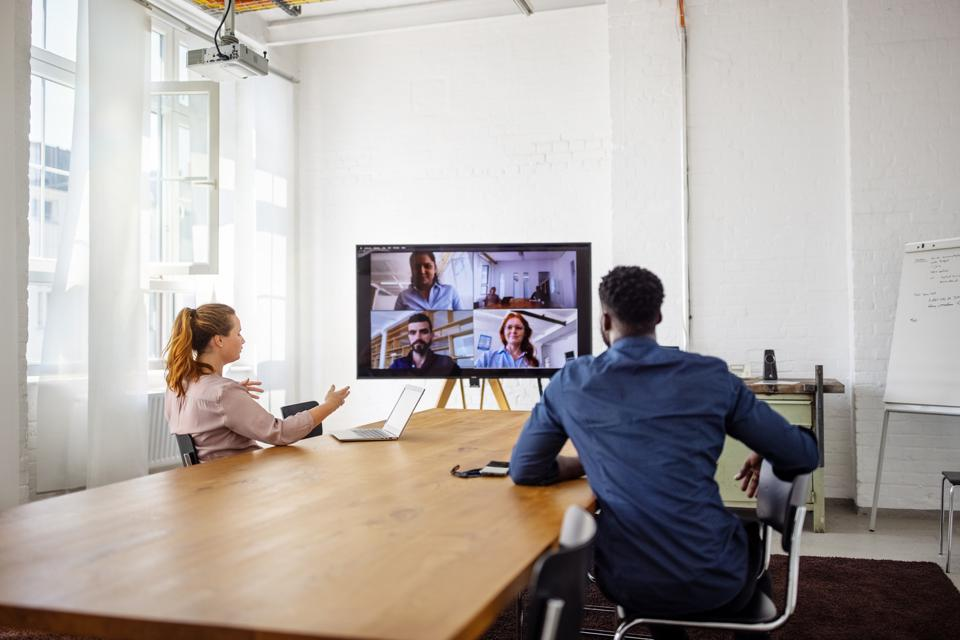 Businesspeople having a video conference in office