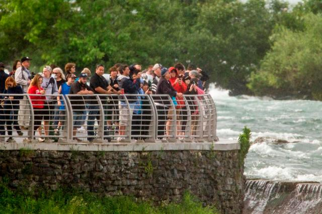 Crowds gather at Terrapin Point on Goat Island in Niagara Falls, New York.
