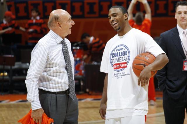 Jeffrey Jordan and Dick Vitale talk before a game