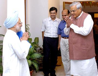 Atal Bihari Vajpayee greets his successor Dr Manmohan Singh