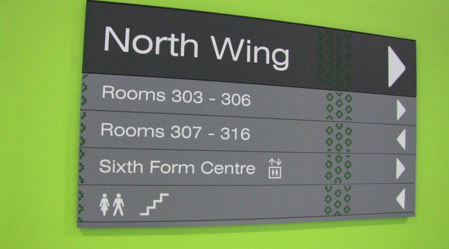 Sussex artist teams up with students and leading UK sign manufacturer to develop the signage and wayfinding scheme for two new schools