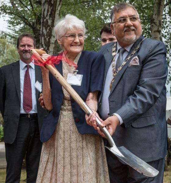 91-Year-old former employee Edna Barnett helps The Mayor of Crawley, Councillor Raj Sharma, bury Vent-Axia's time