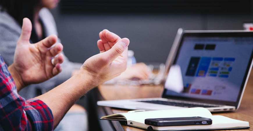 man talking hands laptop
