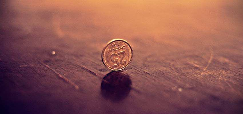 Coin on a wooden floor