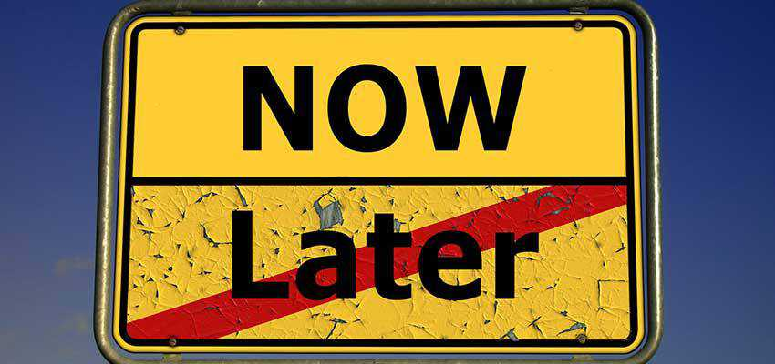 """A road sign with sections that say """"NOW"""" and """"Later""""."""