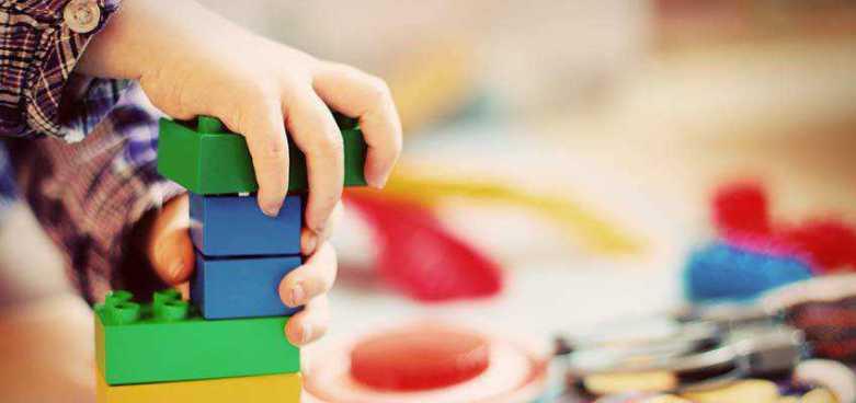 Child stacking blocks.