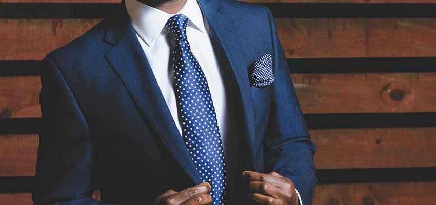 Man wearing a blue suit.