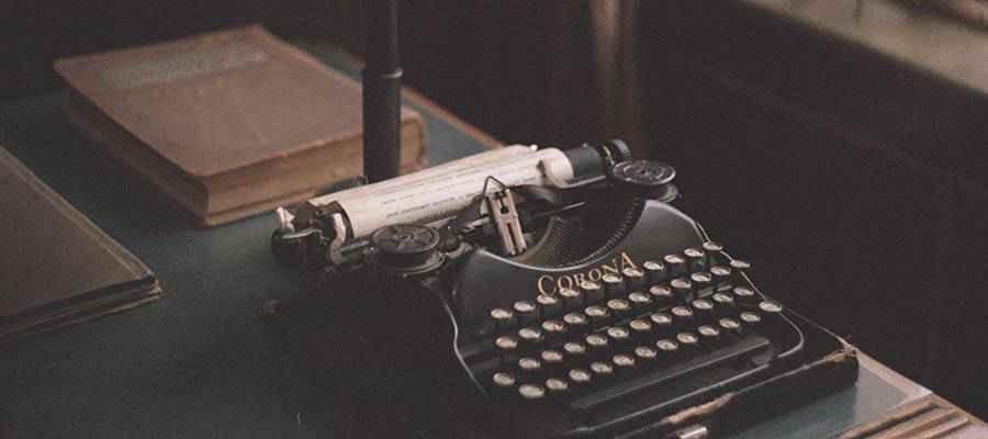 A typewriter on a desk.