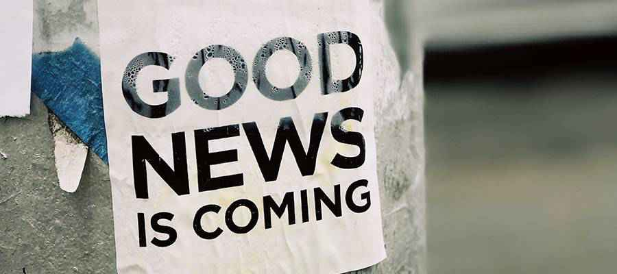 """A sign that reads: """"Good News is Coming""""."""