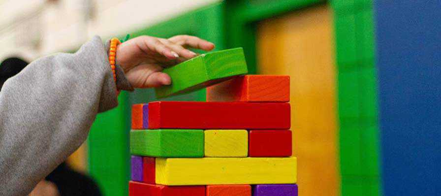 A person with toy blocks.