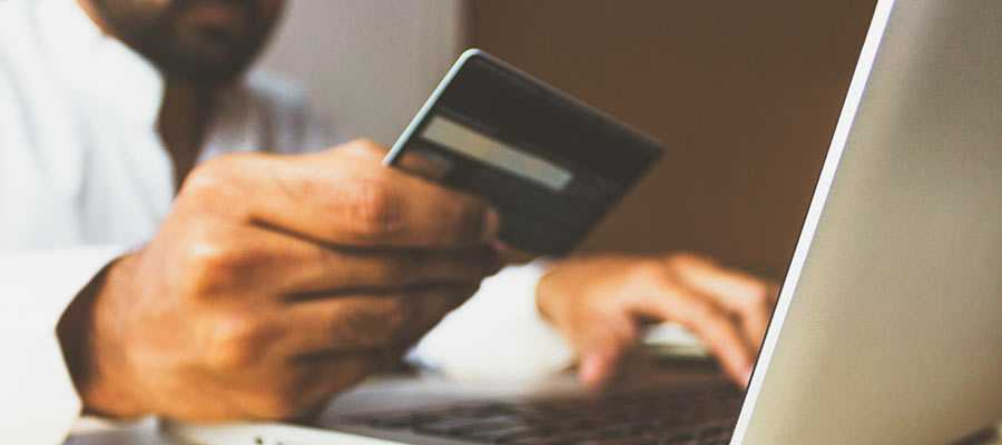 A person holding a credit card.