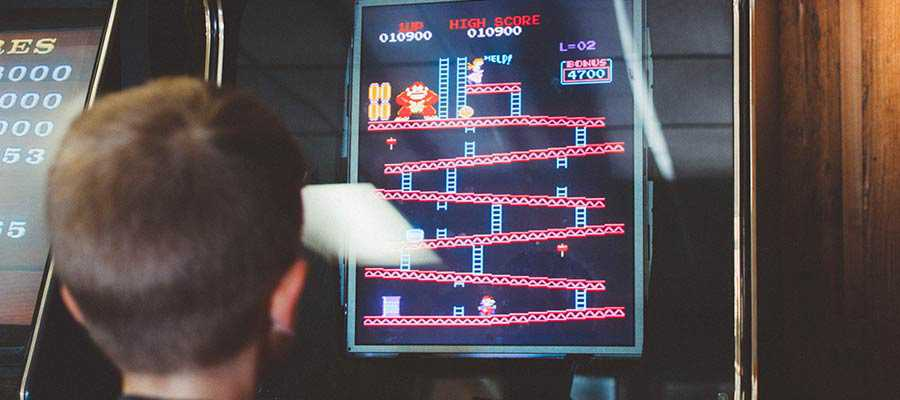 A child plays a game of Donkey Kong.