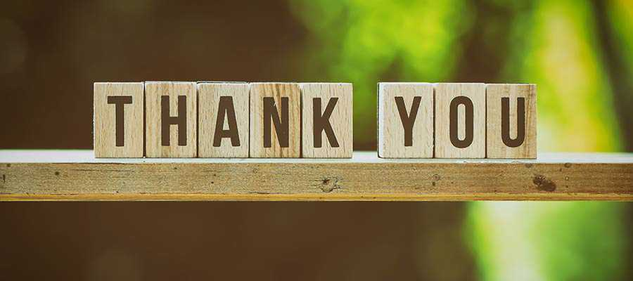 """A sign that reads """"Thank You""""."""